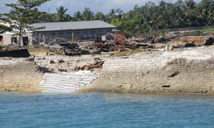 A community in Kiribati builds a sea wall. Kiribati is particularly vulnerable to sea levels: 97% of its land mass is less than five metres above sea level.
