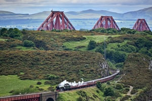 Fife, Scotland The Flying Scotsman steam train is seen after crossing the Forth Bridge, as it makes a journey towards Edinburgh.