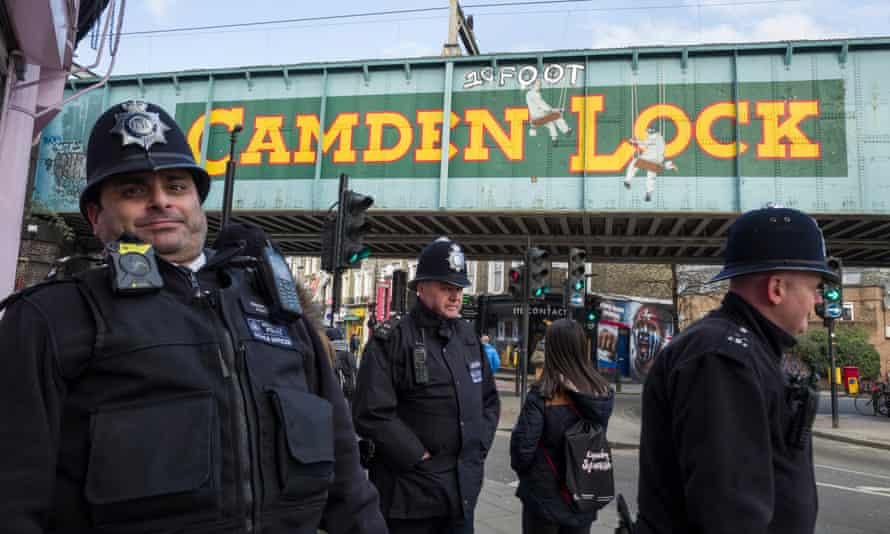 Police on patrol at Camden lock, close to the scene of recent knife crime.