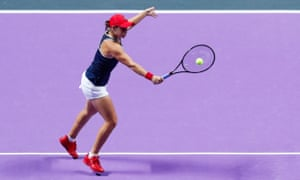 Ashleigh Barty plays a backhand volley during her 6-4, 6-3 victory over Elina Svitolina in the WTA Finals.