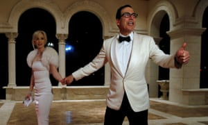 The treasury secretary, Steven Mnuchin, and his wife Louise Linton arrive for the New Year's Eve party at Mar-a-Lago club.