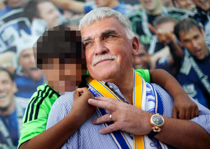 Chairman of Page Group, Stuart Page and his son at Stamford Bridge. (NB face of child has been pixellated)