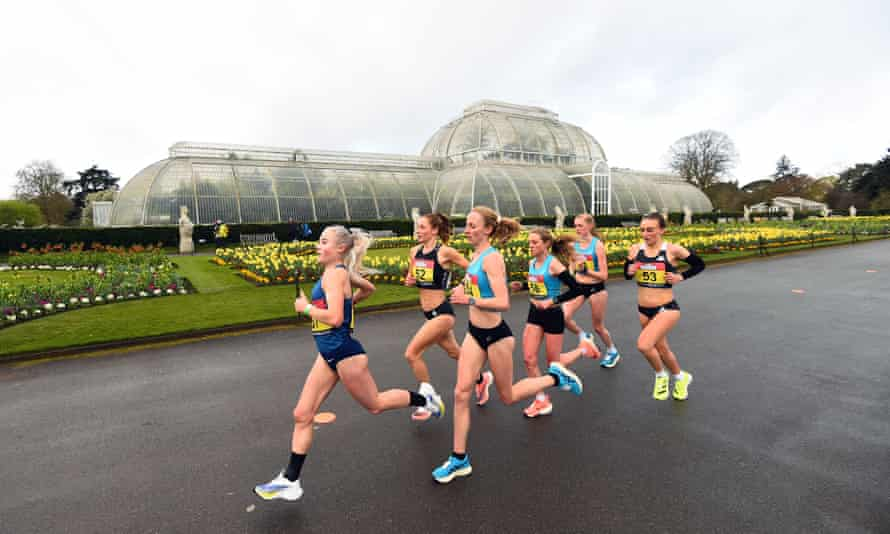 Stephanie Davis, wearing No 52, settles into the leading pack in front of the Palm House at Kew Gardens on Friday.