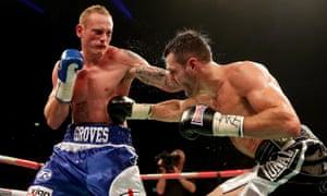 George Groves and Carl Froch trade blows during their world super-middleweight fight in Manchester in November 2013