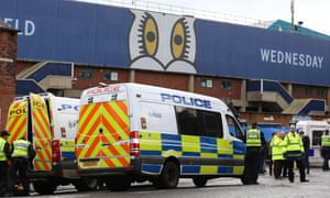Police at Hillsborough. The South Yorkshire force intends to 'adopt a more community style of policing' at football.
