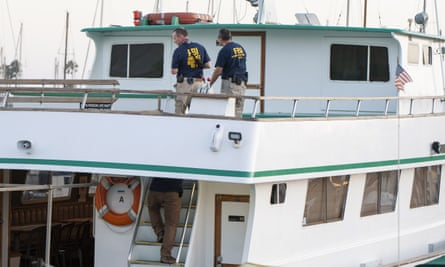 FBI investigators climb aboard the Vision, a sister vessel to the scuba boat Conception to document its layout and learn more about the deadly pre-dawn fire in Santa Barbara, California.