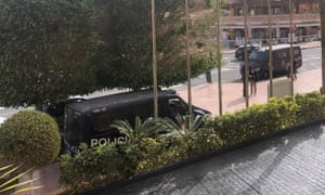 Police vans parked outside the Costa Adeje Palace hotel in Tenerife.