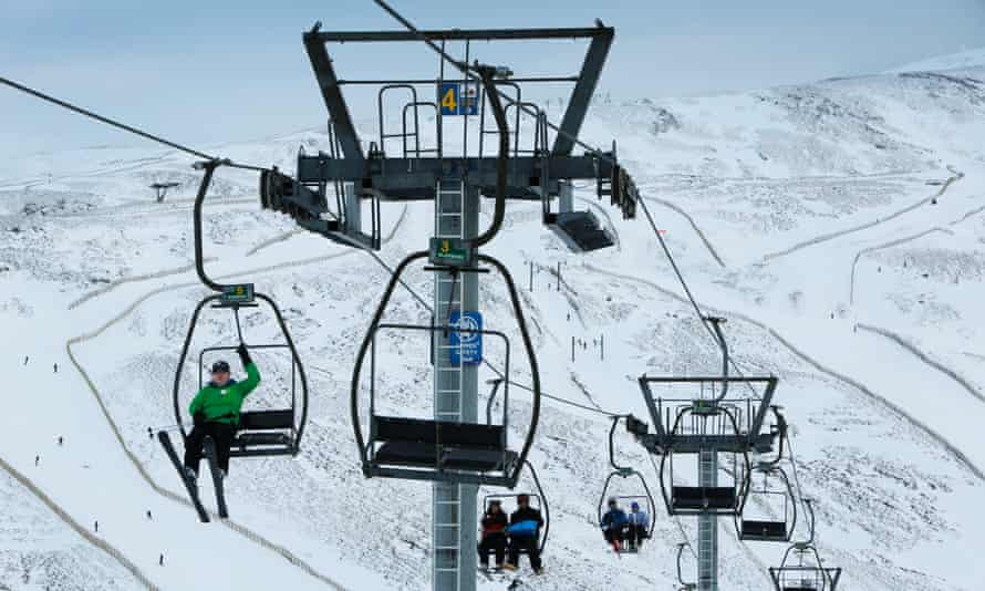 Skiers and snowboarders at Glenshee Ski Centre.