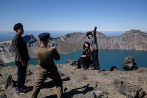 Samjiyon, North Korea: Students pose for photos as they march to the summit of Mount Paektu