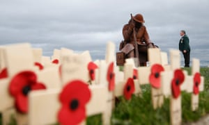 Larry Roberts, 60, a veteran from South Shields, looks at the sculpture Eleven 'O' One in Seaham, County Durham
