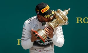Lewis Hamilton kisses the trophy after winning the F1 British Grand Prix at Silverstone.