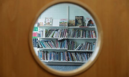 Books through the window of a closed school library