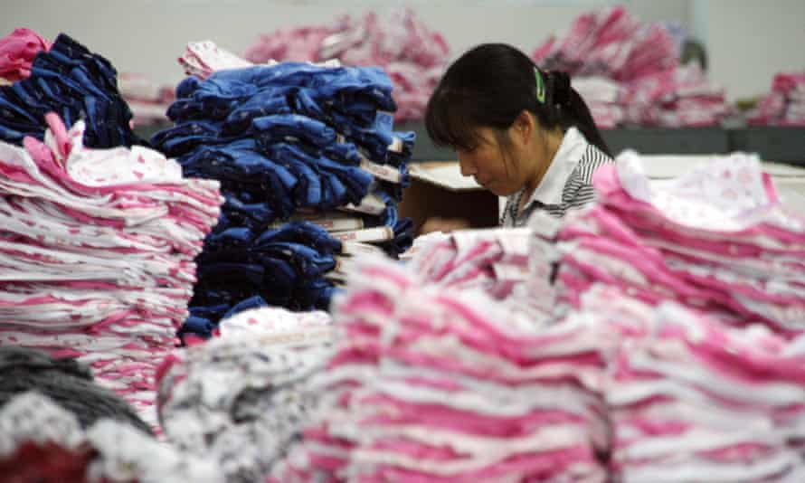 A worker sews undergarments at a textile factory in Jinjiang in Fujian province in south-east China