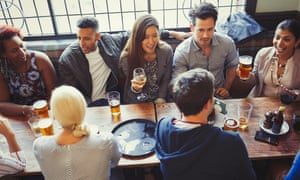 Young people drink at a pub