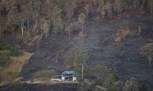 A burnt-out paddock surrounds a house near Lamington National Park Road, Canungra, in the Gold Coast hinterland of Queensland, on Saturday.