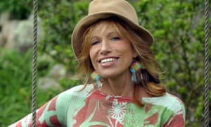 Carly Simon poses with her guitar at her home in Martha's Vineyard in May 2004.