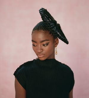 Zainab wears black pleated dress by Jil Sander at matchesfashion.com, and earrings, tohumdesign.com.