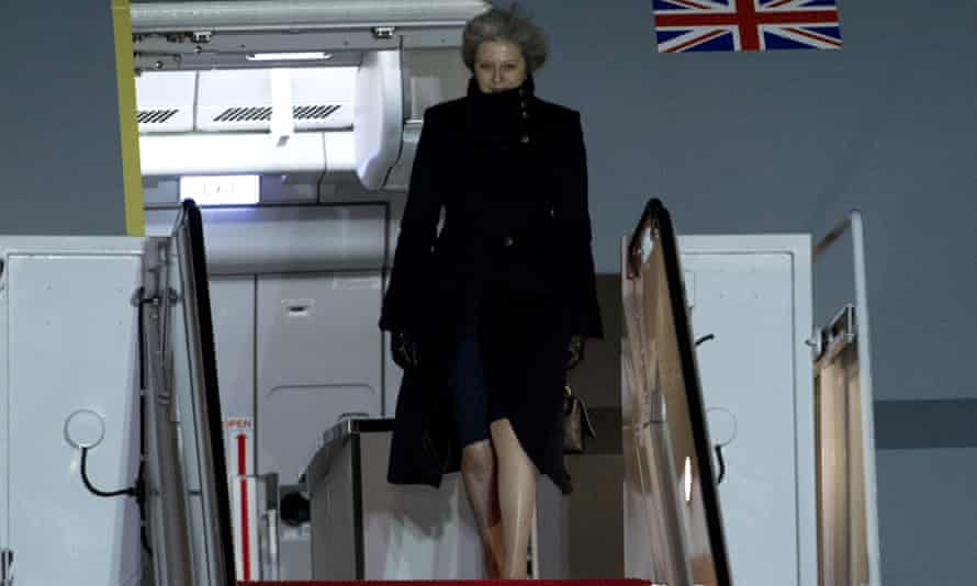 Theresa May steps off from her plane at Andrews air force base near Washington DC where she will meet Donald Trump on Friday.