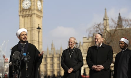 From left, Sheikh Mohammed al Hilli, Justin Welby, the Archbishop of Canterbury, the chief rabbi, Ephriam Mirvis, and Sheikh Ezzat Khalifa outside Westminster Abbey.