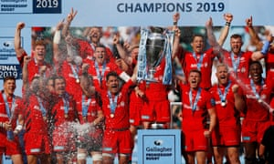 Saracens players celebrate winning the Premiership final.