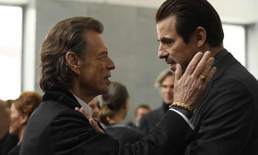This image released by Sony Pictures Classics shows Mick Jagger, left, and Claes Bang in The Burnt Orange Heresy.