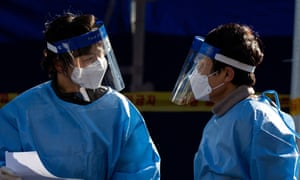Medical professionals work at a makeshift coronavirus testing clinic at Seoul Station in Seoul, South Korea.