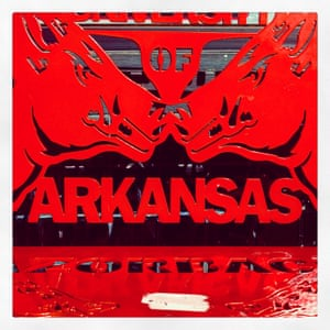 A bench outside a restaurant displays the razorbacks, also known as the hogs, the symbols of college sports teams at the University of Arkansas