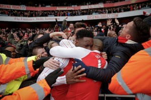 Danny Welbeck celebrates with Theo Walcott after Welbeck scored the winning goal in the final minute at the Emirates