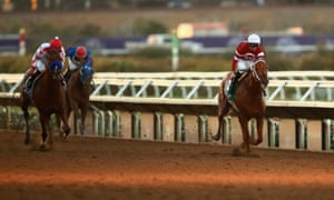 Gun Runner, right, ridden by Florent Geroux, defeats Collected, left.