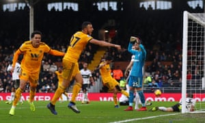 Romain Saiss (second left) celebrates after getting Wolves back on level terms.