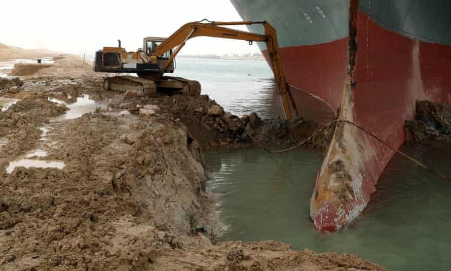 Salvage efforts have included digging under the Ever Given where it is wedged onto the Suez canal's banks.