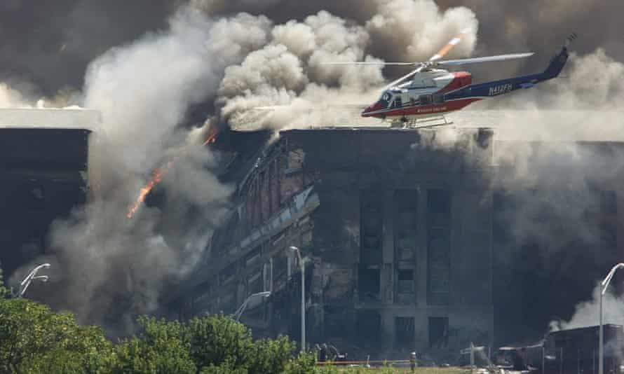 A rescue helicopter surveying damage to the Pentagon after a hijacked plane crashed into during the 9/11 terrorist attack in 2001.