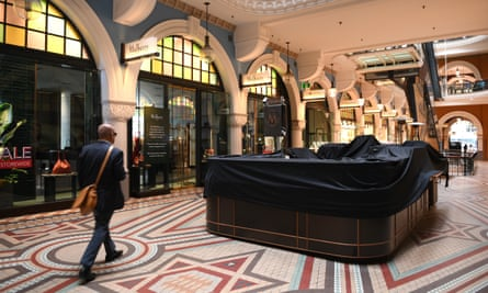 Closed businesses are seen at the Queen Victoria Building in Sydney