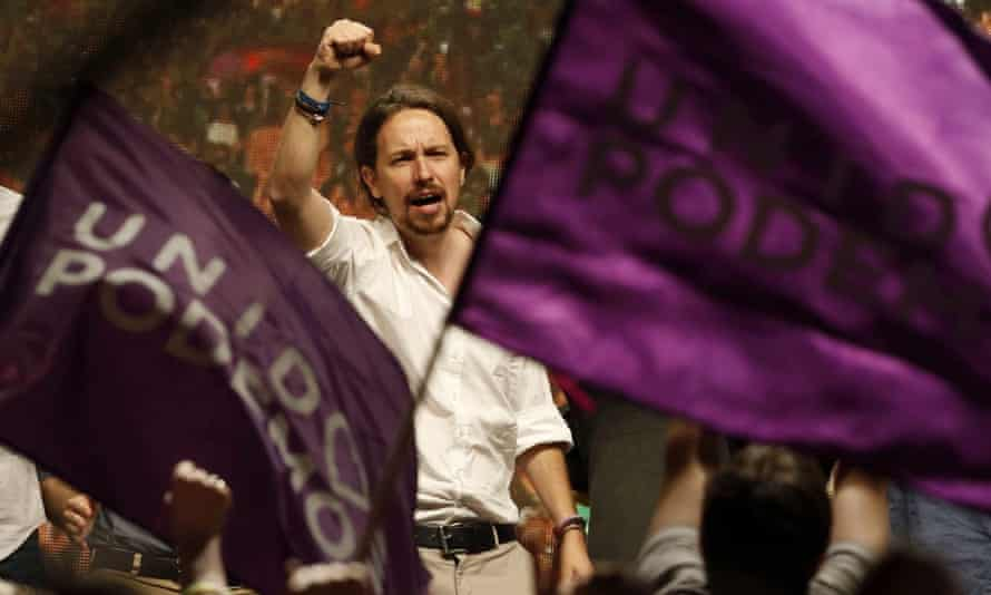 The leader of Podemos, Pablo Iglesias, celebrates with supporters in Madrid