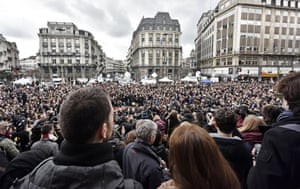 People observe a minute of silence at the Place de la Bourse in the center of Brussels