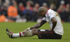 Manchester United's Ashley Young sits on the pitch at Liverpool after sustaining his groin injury