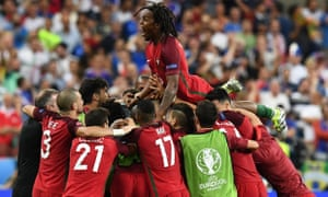 Portugal's Renato Sanches jumps on teammates after Eder scores.