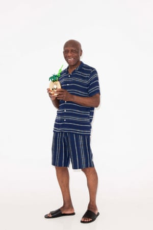 blue and white striped shirt and shorts Whistles, black sliders Cos, pineapple drink holder Urban Outfitters