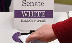 A woman casts her vote for members of the senate in the Australian Federal Election in Melbourne on 2 July 2016.