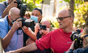 Photojournalists take pictures of Dominic Cummings as he leaves his home