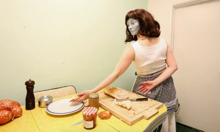 A 2016 video installation shows Johnson, wearing a mask made from an old photo of her grandmother, trying to prepare a meal.