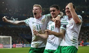 Robbie Brady, centre, celebrates with team-mates James McClean, left, and Stephen Ward after the Republic of Ireland's victory over Italy.