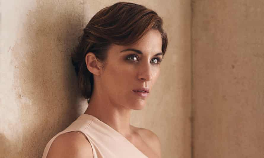 Vicky McClure in semi-profile, leaning against a wall