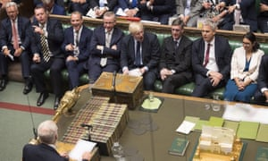 Boris Johnson, with his front bench MPs, face Jeremy Corbyn in the House of Commons