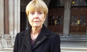 Joy Williams in black coat outside court