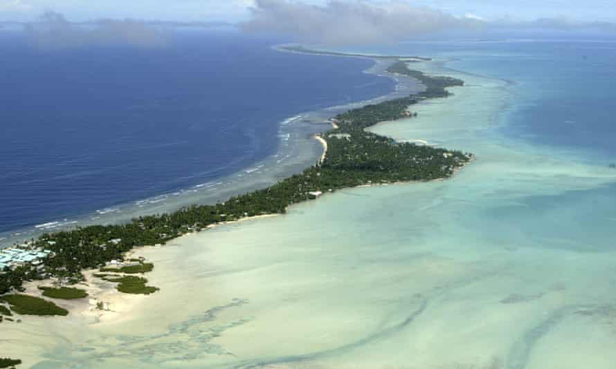 Rising sea levels caused by global warming threaten the very existence of the tiny Pacific nation of Kiribati, one of the lowest countries on the planet.