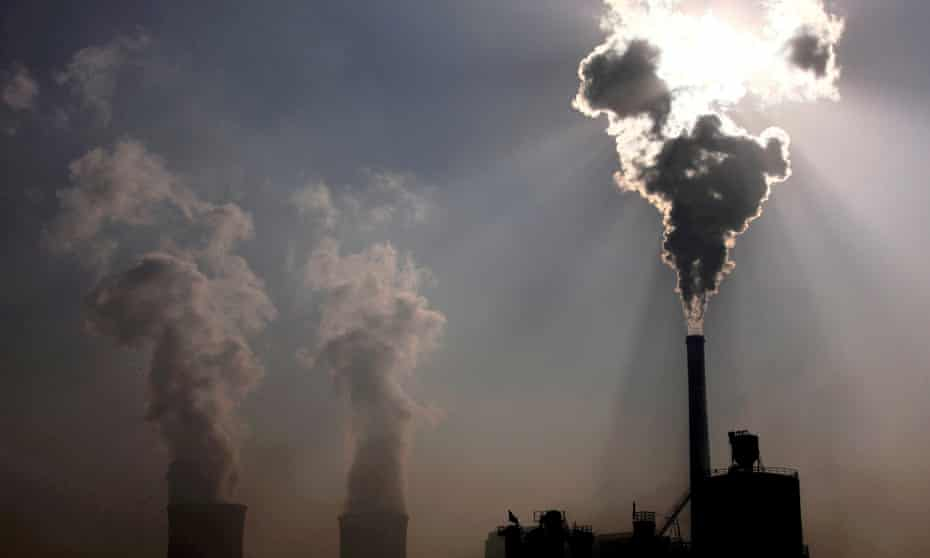 A coal-burning power plant spews pollution into the air in the city of Baotou, in Inner Mongolia, China.