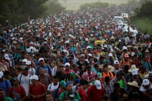 A caravan of thousands of migrants from Central America, en route to the United States, makes its way to San Pedro Tapanatepec from Arriaga, Mexico