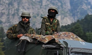 Indian army soldiers move along the Srinagar-Leh national highway close to the border in the Ladakh region