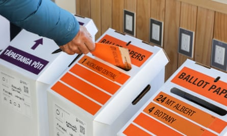 A man casts his ballots for the 2020 General Election at a voting place in Auckland, New Zealand
